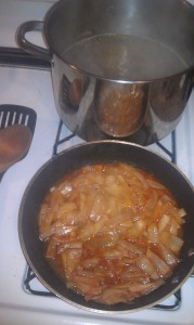 Potatoes simmering in the back, onions doing their thing in the front (I added liquid to them just before taking this).